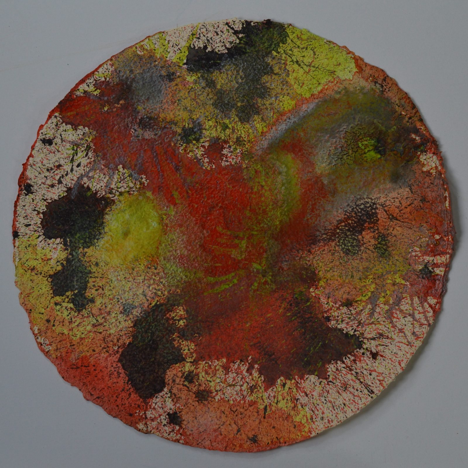 Chamukuy is an abstract 50cm circular painting. Layers of splatters lie beneath explosions of vermilion, lemon yellow, oxide black and silver in this vibrant abstract. Part of the Day the Sky Shattered and Flew Away series.