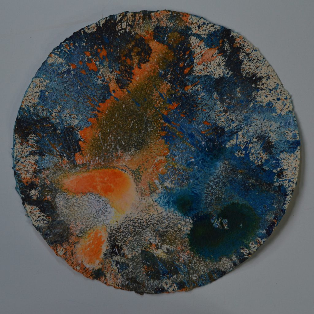 Tarazed is an acrylic on Moulin de Larroque paper abstract circular painting 50cm in diameter. Blues and greens form an incomplete background, partly splattered. Organic orange and blue-green shapes float whilst some areas look quite scaly due to the layers of paint and texture of the paper. Part of The Day the Sky Shattered and Flew Away series.