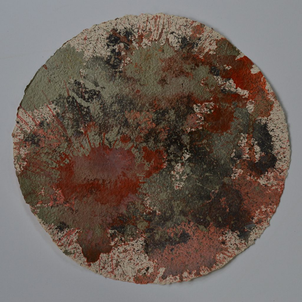 Fafnir is a dark, explosive painting in vermilion, oxide black and silver. These muted colours explode over the surface of the textured handmade paper which is a 50cm circle. Part of the Day the Sky Shattered and Flew Away series.
